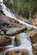 Ripley Falls on Avalanche Brook in Hart's Location, New Hampshire during the autumn months. Located in Crawford Notch, and named for H.W. Ripley, this waterfall was discovered in the 1850s (maybe earlier). The Arethusa-Ripley Falls Trail travels pass this scenic waterfall.