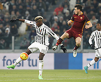 Juventus' Paul Pogba is challenged by Roma's Alessandro Florenzi during the Italian Serie A football match between Juventus and Roma at Juventus Stadium.