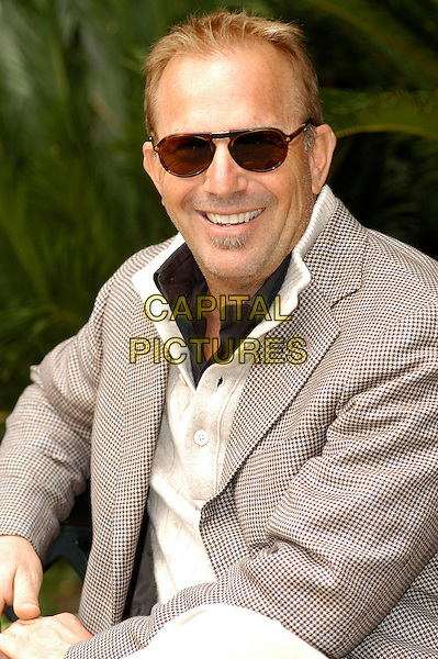 """KEVIN COSTNER.Photocall for """"Modern West"""", Kevin Costner band, Hotel De Russie, Rome, Italy..October 24th, 2007.half length sunglasses shades beige jacket .CAP/CAV.©Luca Cavallari/Capital Pictures."""