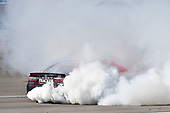 2017 Monster Energy NASCAR Cup Series - Kobalt 400<br /> Las Vegas Motor Speedway - Las Vegas, NV USA<br /> Sunday 12 March 2017<br /> Martin Truex Jr, Bass Pro Shops/TRACKER BOATS Toyota Camry celebrates his win with a burnout<br /> World Copyright: Nigel Kinrade/LAT Images<br /> ref: Digital Image 17LAS1nk07768