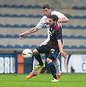 Raith Rovers' Calum Elliot and Caley's Graeme Shinnie challenge for the ball.