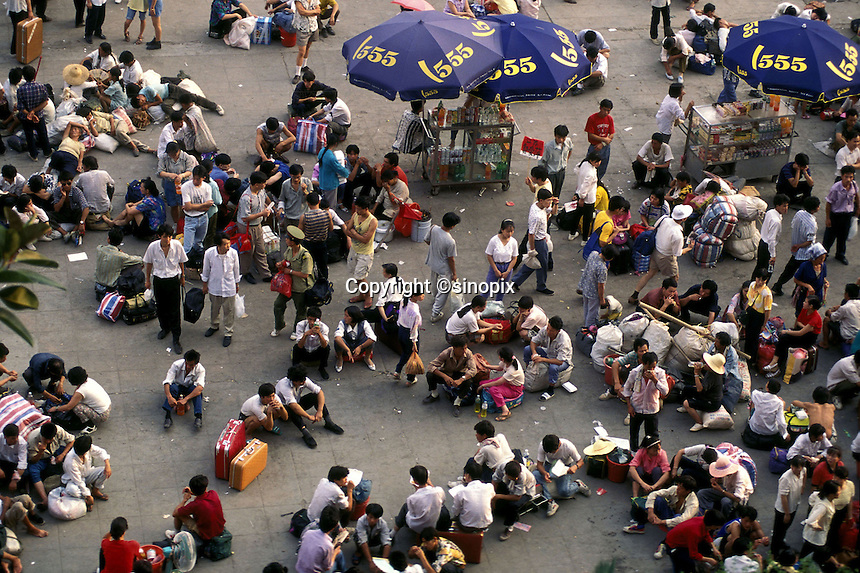 Migrant workers wait at Guangzhou railway station to return home for Chinese New Year. Around a 100 million workers make the trip from often distant  places of work for the Lunar Year celebrations.