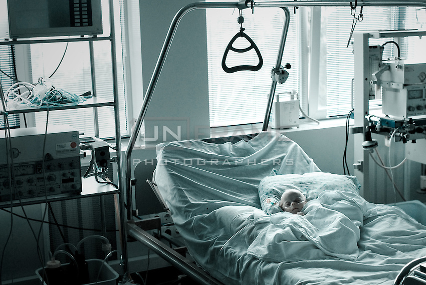 Child receiving post operational medical assistance in ICU unit.