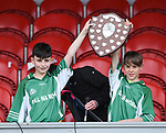 Tadgh Kerins and Gearoid Barry of Kilnamona lift the trophy after the win over Mountshannon/Lackyle in their Schools Division 3 final at Cusack Park. Photograph by John Kelly