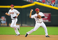 May 3, 2011; Phoenix, AZ, USA; Arizona Diamondbacks shortstop Stephen Drew (left) looks on as third baseman Melvin Mora throws to second base against the Colorado Rockies at Chase Field. Mandatory Credit: Mark J. Rebilas-
