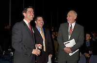 March 20 2003, Montreal, Quebec, Canada<br /> <br /> David Anderson, Canada's Environment Minister (R) and Andre Boisclair , Quebec's Environment Minister (L)joke with Martin Dussaault, President of Reseau Environnemet at  the Opening plenary Session of Americana, a 3 days <br /> conference & trade show on environement and waste management organized by Reseau Environnement, March 20 2003 in Montreal, Canada.<br /> <br /> Mandatory Credit: Photo by Pierre Roussel- Images Distribution. (©) Copyright 2003 by Pierre Roussel <br /> <br /> NOTE : <br />  Nikon D-1 jpeg opened with Qimage icc profile, saved in Adobe 1998 RGB<br /> .Uncompressed  Original  size  file availble on request.