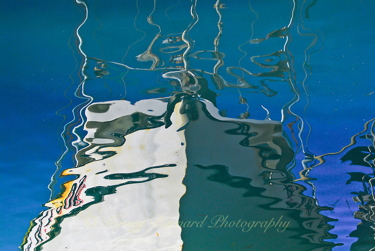 """""""DOWN TO THE SEA""""<br /> <br /> Reflections of a fishing boat in Morro Bay Harbor."""