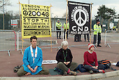 Buddhists meditate in front of CND banners outside the Atomic Weapons Establishment (AWE) at Aldermaston on Easter Monday, at the end of a four day march from Trafalgar Square in central London.