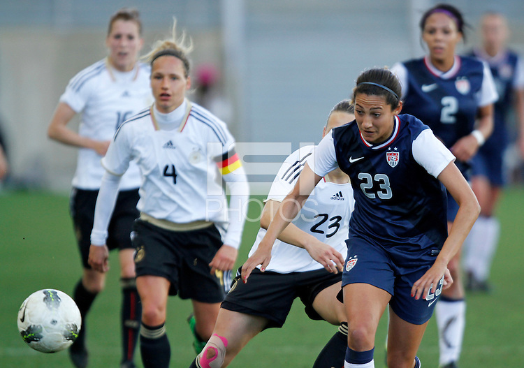 US's Christen Press fights for the ball with Germany's Josephine Henning during their Algarve Women's Cup soccer match at Algarve stadium in Faro, March 13, 2013.  .Paulo Cordeiro/ISI