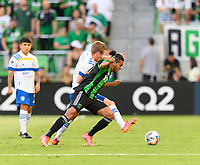AUSTIN, TX - JUNE 19: Cecilia Dominguez #10 of Austin FC and Jackson Yueill #14 of the SJ Earthquakes battle for control of the ball during a game between San Jose Earthquakes and Austin FC at Q2 Stadium on June 19, 2021 in Austin, Texas.
