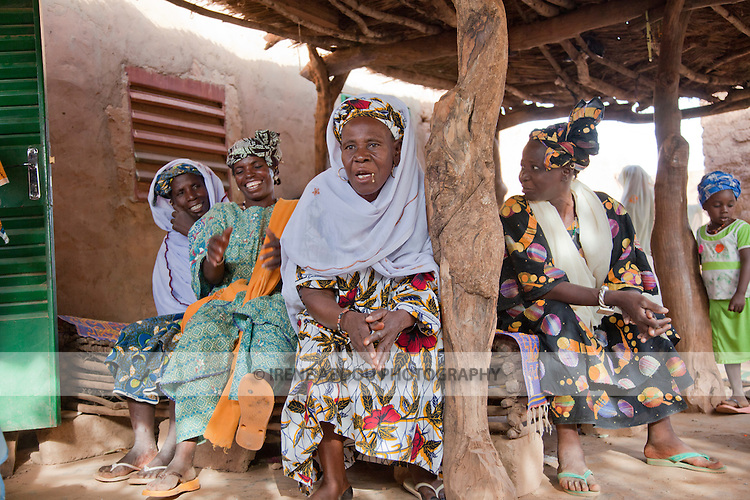 """In the town of Djibo in northern Burkina Faso, a Fulani wedding has taken place.  Friends and family of the bride congregate on the groom's home on the day of the """"bantule"""" when the bride's gifts, possessions, and new furniture are brought to her."""