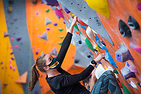 "Tuva Bygrave makes her way up a ""boulder"" as Alaska Rock Gym operations manager and UAA recreation course instructor Eric Wickenheiser teaches Beginning Indoor Sport Climbing (PER A148) at the Alaska Rock Gym in Anchorage."