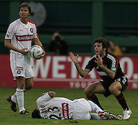 OCT 30, 2005: Washington, DC, USA:  DC United midfielder Ben Olsen (14) can't believe a foul is  called on him while playing the Chicago Fire at RFK Stadium.  DC United lost, 4-0.  With the loss, the Chicago Fire advanced on a 4-0 aggregate score over two games.
