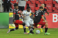 WASHINGTON, DC - SEPTEMBER 27: Cristian Penilla #70 of New England Revolution battles for the ball with Oniel Fisher #91 and Junior Moreno #5 of D.C. United during a game between New England Revolution and D.C. United at Audi Field on September 27, 2020 in Washington, DC.