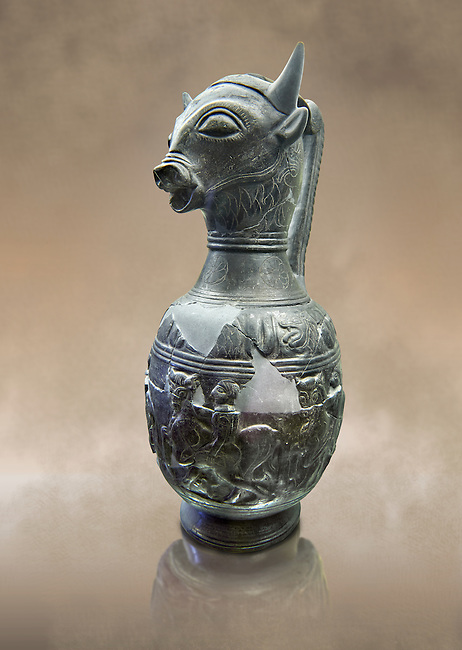 Three quarters view of the 6th century BC Etruscan Bull headed bucherro style oinochoe, or wine jug,  made in Chuisi and excavated from the necropolis de Fonte Rotella, inv 3190, National Archaeological Museum Florence, Italy