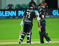 NZ's Daryl Mitchell congratulates Glenn Phillips on his 50 during the second International T20 cricket match between the New Zealand Black Caps and Bangladesh at McLean Park in Napier, New Zealand on Tuesday, 30 March 2021. Photo: Dave Lintott / lintottphoto.co.nz