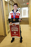 Ottawa, ON - March 28 2014- Sochi 2014 Paralympic Games bronze medallist Ben Delaney of the sledge hockey team displays his limited edition gold-plated coin and personalized Welcome Home banner at the CIBC Paralympic Welcome Home Event at CIBC South Keys Banking Centre in Ottawa  (Photo: Patrick Doyle/CIBC)