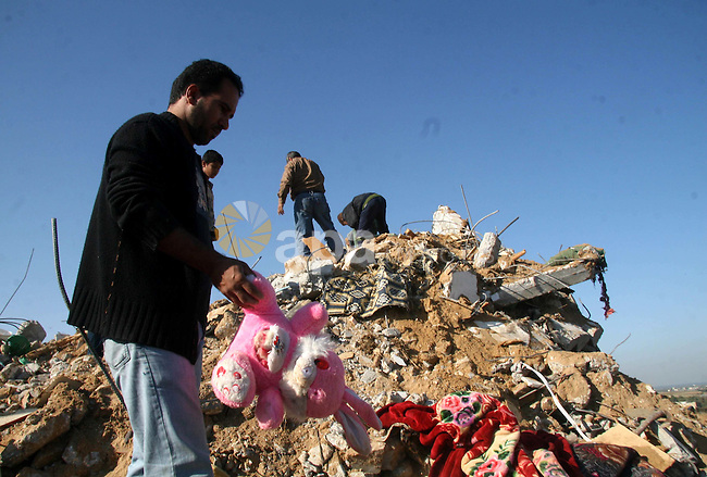 Palestinians inspect the rubble from the destroyed house of a relative following an overnight Israeli army operation in Deir al-Balah, near the border between the Gaza Strip and Israel. Dozens of rockets were fired at Israel today after Israeli military operations in Gaza killed six Palestinians, in the most serious incidents since a fragile truce went into effect in June.