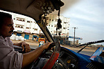 A shared taxi driver navigates the road from Taezz to Aden, Yemen, Nov. 30, 2009. Lawlessness, growing poverty, a water crisis, a raging conflict with Houthi rebels in Yemen's north and clashes with separatists in the South continue to destabilize the Arabian Peninsula's poorest state.