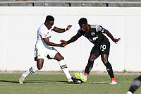 RICHMOND, VA - SEPTEMBER 30: Akeem Ward #30 of North Carolina FC and Cherif Dieye #70 of New York Red Bulls II challenge for the ball during a game between North Carolina FC and New York Red Bulls II at City Stadium on September 30, 2020 in Richmond, Virginia.