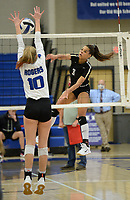 Bentonville's Trinity Hamilton (3) sends the ball over the net Tuesday, Oct. 13, 2020, as Rogers' Lakyn Hawthorne (10) defends during play in King Arena in Rogers. Visit nwaonline.com/201014Daily/ for today's photo gallery. <br /> (NWA Democrat-Gazette/Andy Shupe)