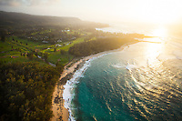 An aerial view of the beach and golf course of Turtle Bay Resort at sunset, O'ahu.