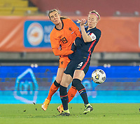 BREDA, NETHERLANDS - NOVEMBER 27: Jill Roord #19 of the Netherlands collides with Becky Sauerbrunn #4 of the USWNT during a game between Netherlands and USWNT at Rat Verlegh Stadion on November 27, 2020 in Breda, Netherlands.