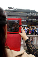 A woman uses her iPad to take pictures at the Yuyuan Garden.<br /> <br /> To license this image, please contact the National Geographic Creative Collection:<br /> <br /> Image ID: 2169179  <br /> <br /> Email: natgeocreative@ngs.org<br /> <br /> Telephone: 202 857 7537 / Toll Free 800 434 2244<br /> <br /> National Geographic Creative<br /> 1145 17th St NW, Washington DC 20036
