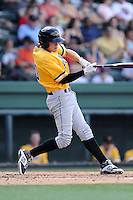 Designated hitter JaCoby Jones (10) of the West Virginia Power bats in a game against the Greenville Drive on Sunday, May 11, 2014, at Fluor Field at the West End in Greenville, South Carolina. Jones is the No. 19 prospect of the Pittsburgh Pirates, according to Baseball America. Greenville won, 9-6. (Tom Priddy/Four Seam Images)