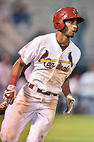 Johnson City Cardinals shortstop Oscar Mercado #4 runs to first during a game against the Danville Braves at Howard Johnson Field September 4, 2014 in Johnson City, Tennessee. The Braves defeated the Cardinals 6-1. (Tony Farlow/Four Seam Images)