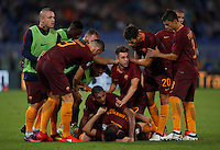 Calcio, Serie A: Roma vs Inter. Roma, stadio Olimpico, 2 ottobre 2016.<br /> Roma's Kostas Manolas, bottom, is hidden by his teammates' hugs after scoring the winning goal during the Italian Serie A football match between Roma and FC Inter at Rome's Olympic stadium, 2 October 2016. Roma won 2-1.<br /> UPDATE IMAGES PRESS/Isabella Bonotto