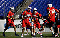 Dean Hart (16) of Maryland celebrates winning the game with teammates Grant Catalino (1), Ryan Young (27) and Brian Farrell during the Face-Off Classic in at M&T Stadium in Baltimore, MD