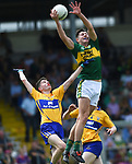 Diarmuid Ryan of Clare in action against Adam Donoghue of Kerry during their Minor Munster final at Killarney.  Photograph by John Kelly.
