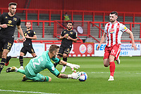 Laurie Walker of MK Dons F.C. comes to smother the ball from the incoming Danny Newton of Stevenage F.C. during Stevenage vs MK Dons, EFL Trophy Football at the Lamex Stadium on 6th October 2020