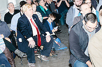 Donald Trump impersonator Eric Jackman, of Jaffrey, New Hampshire, sits in the audience as Texas senator and Republican presidential candidate Ted Cruz speaks during a town hall event at Peterborough Town House in Peterborough, New Hampshire, on Sun., Feb. 7, 2016.