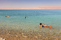 Israel, Galilee, Dead sea,Ein Bokek, turists take a bath in the salt water