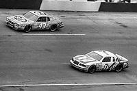 HAMPTON, GA - NOV 3:  Richard Petty, #43 Pontiac, and Kyle Petty, #7 Ford, race through a turn during the Atlanta Journal 500 NASCAR Winston Cup race at Atlanta Motor Speedway, November 3, 1985. (Photo by Brian Cleary/www.bcpix.com)