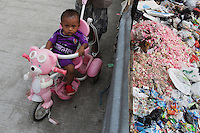 A young child near a dump site in a slum community in central Jakarta. It is estimated over 25% of Indonesians live in slum areas, with more than 5 million people living in slum areas in the greater Jakarta area.