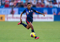 FRISCO, TX - MARCH 11: Crystal Dunn #19 of the United States dribbles during a game between Japan and USWNT at Toyota Stadium on March 11, 2020 in Frisco, Texas.