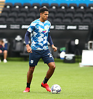 25th September 2021; Swansea.com Stadium, Swansea, Wales; EFL Championship football, Swansea versus Huddersfield; Levi Colwill of Huddersfield Town warms up before the game