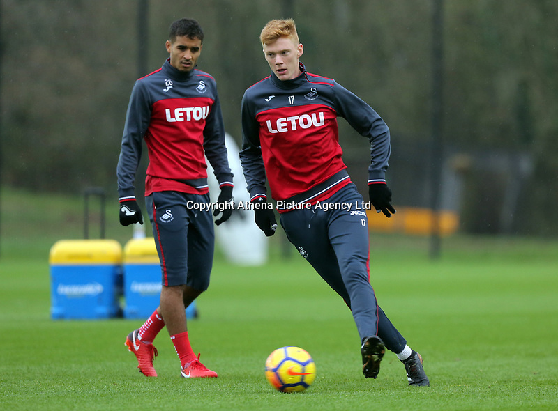 (L-R) Kyle Naughton and Sam Clucas in action during the Swansea City Training at The Fairwood Training Ground, Swansea, Wales, UK. Wednesday 22 November 2017
