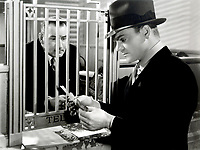 James Cagney and Edward Keane (L) in G MEN