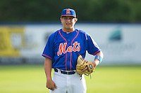 Dillon Becker (50) of the Kingsport Mets warms up in the outfield prior to the game against the Elizabethton Twins at Hunter Wright Stadium on July 8, 2015 in Kingsport, Tennessee.  The Mets defeated the Twins 8-2. (Brian Westerholt/Four Seam Images)