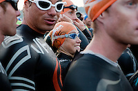 Kristin Moller and other professional triathletes prepare start the 2012 Ironman at 6.25 am with a 3.8 km swim in the sea, Nice, France, 24 June 2012