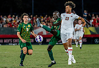 COLLEGE PARK, MD - SEPTEMBER 3: George Mason University defender Jonathan Fawole (27) clashes with Maryland University forward Jacen Russell-Rowe (13) during a game between George Mason University and University of Maryland at Ludwig Field on September 3, 2021 in College Park, Maryland.
