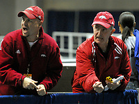 Arkansas Democrat-Gazette/KAREN E. SEGRAVE<br />2/26/06<br /><br />Arkansas' track head coach John McDonnell (right) and an assistant coach (NO ID) cheer on the men running in the 5,000 meter run during the SEC Indoor Track and Field Championships held Sunday at the University of Florida in Gainesville.