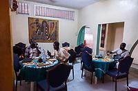 Senegal.  Diners Using Cell Phones in a Roadside Restaurant, Diourbel (Djourbel).