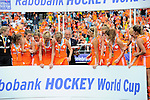 The Hague, Netherlands, June 14: Team of The Netherlands waits for the hand over of the World Cup Trophy during the winners ceremony after the field hockey gold medal match (Women) between Australia and The Netherlands on June 14, 2014 during the World Cup 2014 at Kyocera Stadium in The Hague, Netherlands. Final score 2-0 (2-0)  (Photo by Dirk Markgraf / www.265-images.com) *** Local caption ***