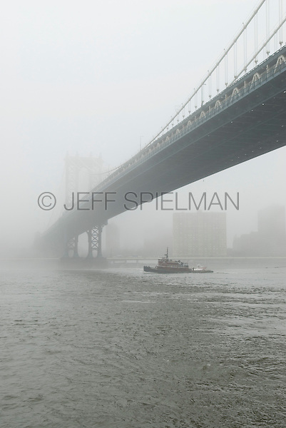 AVAILABLE FROM JEFF AS A FINE ART PRINT.<br /> <br /> AVAILABLE FROM PLAINPICTURE.COM FOR COMMERCIAL AND EDITORIAL LICENSING.  Please go to www.plainpicture.com and search for image # p5690152.  <br /> <br /> Tugboat, Manhattan Bridge, and East River on a Foggy Morning, New York City, New York State, USA