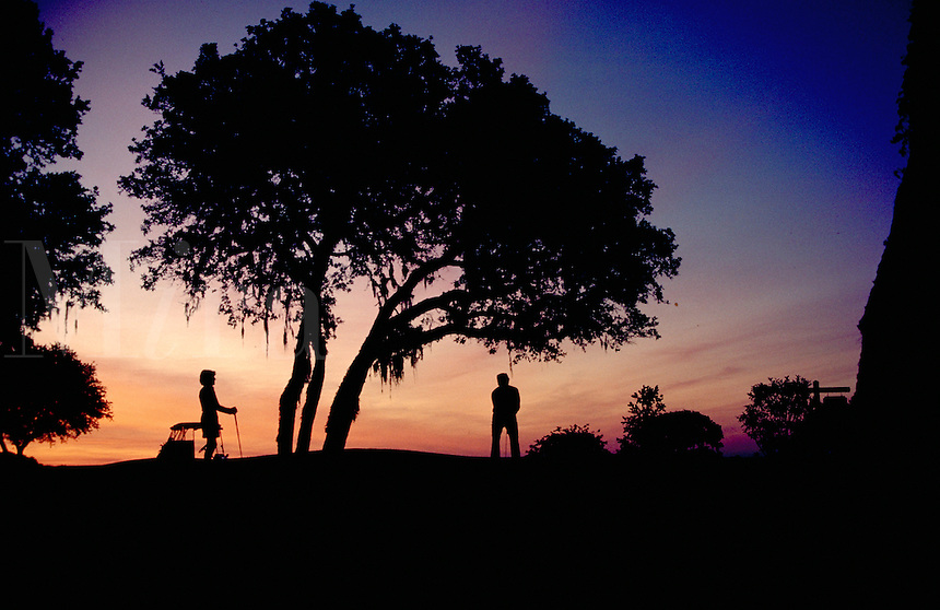 SENIOR COUPLE TEE OFF AT DAWN, SPORTS, GOLFING. LOIS VOSS, WALTER SHERER. WILDWOOD FLORIDA, CONTINENTAL COUNTRY CLUB.